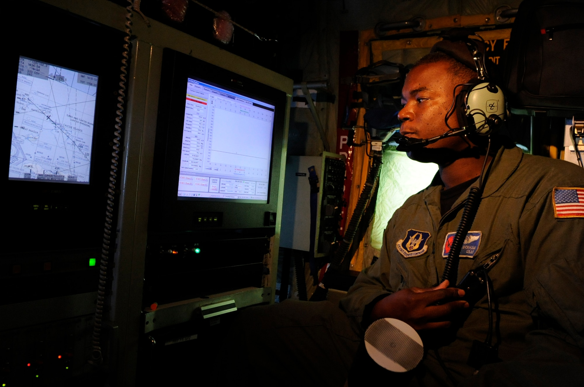 Tech. Sgt. Troy Bickham checks weather data on a training mission recently to St. Croix, V.I., on a WC-130J Hercules from Keesler Air Force Base, Miss. Sergeant Bickham is a weather reconnaissance loadmaster assigned to the Hurricane Hunters of the 53rd Weather Reconnaissance Squadron.  (U.S. Air Force photo/Staff Sgt. Desiree N. Palacios)