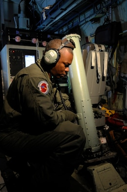 "Tech. Sgt. Troy Bickham loads a dropsonde in the  launch chute on a training mission June 6 to St. Croix, V.I. on a WC-130J  Hercules from Keesler Air Force Base, Miss. Sergeant Bickham is a weather reconnaissance loadmaster assigned to the 53rd Weather Reconnaissance Squadron.  The training mission prepared the Air Force Reserve Command's ""Hurricane Hunters"" as they enter Hurricane Season, which began June 1. (U.S. Air Force photo/Staff Sgt. Desiree N. Palacios)"