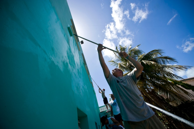 AirmEn of Operation Southern Partner spenD the day painting the 13-classrom exterior of the Stella Maris School for the Physically Disabled June 8 in Belize City, Belize. The operation is meant to enhance the spirit of cooperation between the two countries. (U.S. Air Force photo/Staff Sgt. Bennie J. Davis III)