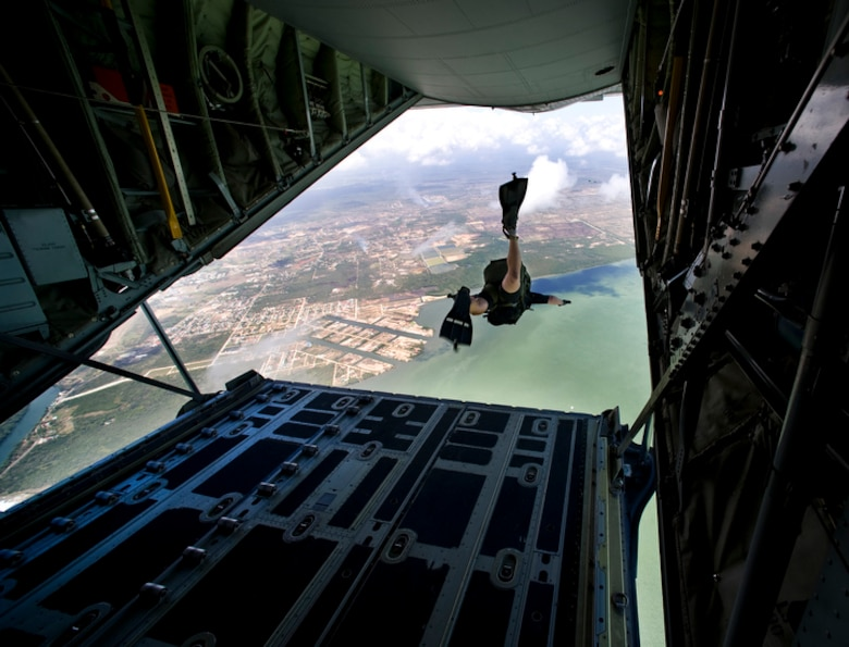 Pararescueman Staff Sgt. Blair Bearny jumps from the back of a C-130J Hercules June 9 to demonstrate a rigged alternate method zodiac, or RAMZ, capability jump into the Caribbean Ocean for members of the Belize National Coast Guard and local media during Operation Southern Partner. (U.S. Air Force photo/Staff Sgt. Bennie J. Davis III)