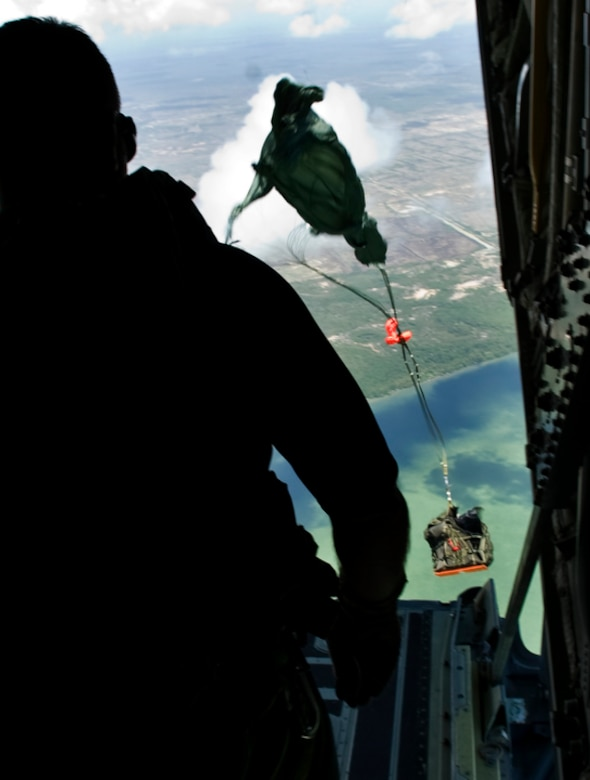 Pararescueman and jump master Senior Master Sgt. Michael Fleming watches as a rigged alternate method zodiac, or RAMZ, package leaves his C-130J Hercules June 9 as part of a demonstration for members of the Belize National Coast Guard and local media during Operation Southern Partner.  (U.S. Air Force photo/Staff Sgt. Bennie J. Davis III)