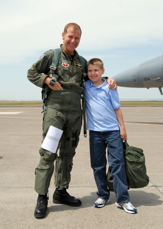 Lt. Col. Reed Drake gets a hug from his son Matthew, his biggest fan.  U.S. Air Force photo by Senior Master Sgt. Eric Peterson.