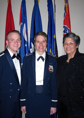 1st Lt. Sarah Flackus from Mountain Home Air Force Base in Idaho stands with her husband, 2nd Lt. Adam Flackus, and the Executive Director of the Air Force Personnel Center, Sheila Earle, following the Department of Defense Meritorious Service Awards banquet in May. (Courtesy photo - Photo cleared for release by AFPC/PA)