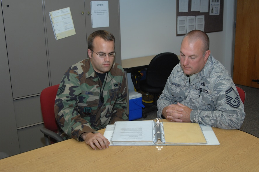 Senior Master Sgt. Steven Windorf, 509th Maintenance Group Quality Assurance Superintendent, and Staff Sgt.  Cory Cahill, 509th Maintenance Group Crew Chief Inspector, are members of a 13-member team that utilized the Air Force Smart Operations 21 (AFSO21) process to resolve problem areas with B-2 bomber flight scheduling.   (U.S. Air Force photo/Master Sgt. Stan Coleman)