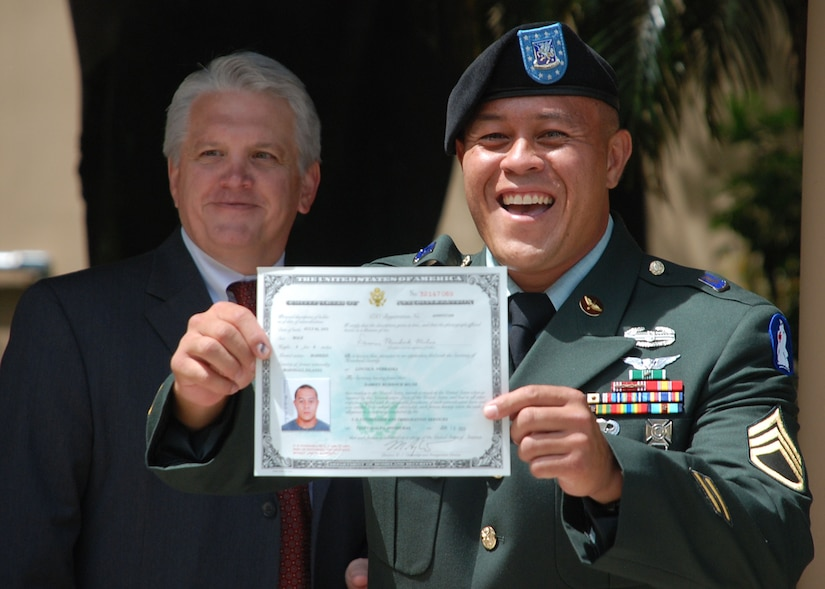 TEGUCIGALPA, Honduras - U.S. Army Staff Sgt. Damien Milne shows off his certificate of U.S. citizenship following his naturalization in a formal ceremony at the U.S. embassy here June 10.  Sergeant Milne is from the Marshall Islands.  He is a two-time Iraq war veteran and is currently assigned to Joint Task Force-Bravo's 1st Battalion, 228th Aviation Regiment.  His ceremony here was the first U.S. naturalization ceremony to take place in Central America.  (U.S. Air Force