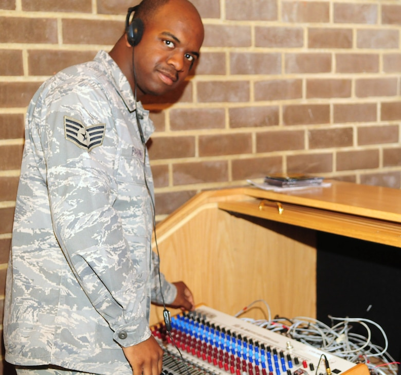 Staff Sgt. Travis Barrino tests out sound equipment June 8 at the Bolling Air Force Base main chapel as he would during a religious service. Chaplain assistants provide support for ministry by acting as carpenters, electricians, cooks, accountants and protocol experts. (U.S. Air Force photo by Airman 1st Class Susan Moreno)