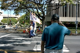 A proud U.S. Air Force veteran salutes as the Joint Service Color Guard passes by, leading off the 93rd King Kamehameha Day Floral Parade in Honolulu, Hawaii, on Saturday, June 13, 2009.  The annual parade features floats, mounted units, and military and high school bands and marching units.  The 4.3-mile parade route starts at Iolani Palace in downtown Honolulu and makes its way through Waikiki to Kapiolani Park.