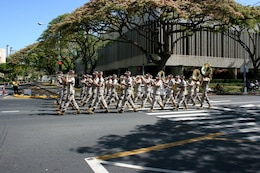 The U.S. Marine Corps Forces Pacific Band serenades onlookers with 'Waltzing Matilda' during the 93rd King Kamehameha Day Floral Parade in Honolulu, Hawaii, on Saturday, June 13, 2009.  The annual parade features floats, mounted units, and military and high school bands and marching units.  The 4.3-mile parade route starts at Iolani Palace in downtown Honolulu and makes its way through Waikiki to Kapiolani Park.