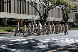 A platoon of Marines from Marine Corps Base Hawaii-Kaneohe Bay marches in the 93rd King Kamehameha Day Floral Parade in Honolulu, Hawaii, on Saturday, June 13, 2009.  The annual parade features floats, mounted units, and military and high school bands and marching units.  The 4.3-mile parade route starts at Iolani Palace in downtown Honolulu and makes its way through Waikiki to Kapiolani Park.