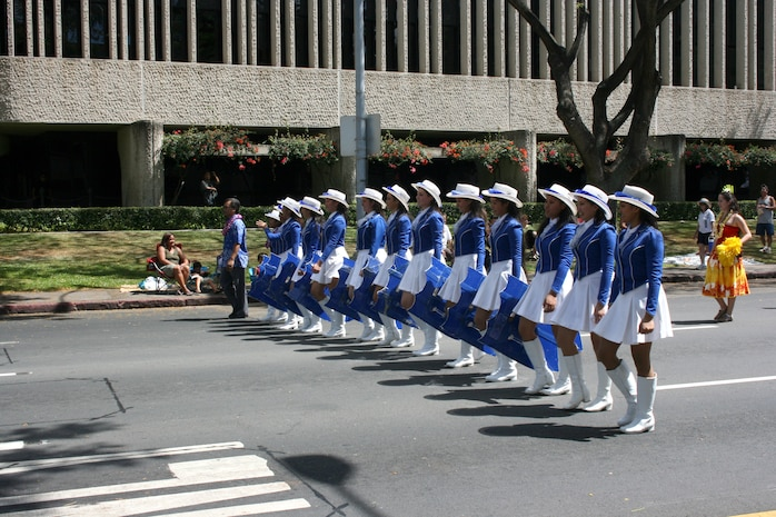 The Warrior Drill Team from Kamehameha Schools in Honolulu marches in the 93rd King Kamehameha Day Floral Parade in Honolulu, Hawaii, on Saturday, June 13, 2009.  The annual parade features floats, mounted units, and military and high school bands and marching units.  The 4.3-mile parade route starts at Iolani Palace in downtown Honolulu and makes its way through Waikiki to Kapiolani Park.