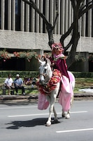 Island of Maui Pa'u Princess Gloria Awakuni rides in the 93rd King Kamehameha Day Floral Parade in Honolulu, Hawaii, on Saturday, June 13, 2009.  The P'au Princesses, representing Maui, Oahu and Kauai, make the lei for themselves and their horses in preparation for this event. The annual parade features floats, mounted units, and military and high school bands and marching units.  The 4.3-mile parade route starts at Iolani Palace in downtown Honolulu and makes its way through Waikiki to Kapiolani Park.