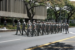 A platoon from U.S. Pacific Air Forces marches in the 93rd King Kamehameha Day Floral Parade in Honolulu, Hawaii, on Saturday, June 13, 2009.  The annual parade features floats, mounted units, and military and high school bands and marching units.  The 4.3-mile parade route starts at Iolani Palace in downtown Honolulu and makes its way through Waikiki to Kapiolani Park.