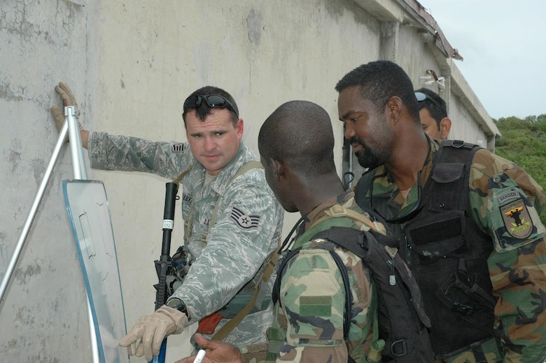 Staff Sgt. Kyle Luker (far left), 820th Security Forces Group, Moody AFB, GA, provides instruction on building entry procedures to 2nd Lt. Javan Simpson (center), and Sgt. Otis Harris, 3rd Battalion, Jamaican Defense Force, during Close Quarters Battle training Monday near Kingston, Jamaica. Luker and more than 60 other personnel of various specialties are participating in Operation Southern Partner, a cooperative exchange program between the U.S Air Force and the defense forces of Belize, Jamaica, Grenada, Guyana, St. Lucia, Trinidad and Tobago. (U.S. Air Force photo by Kevin Walston)