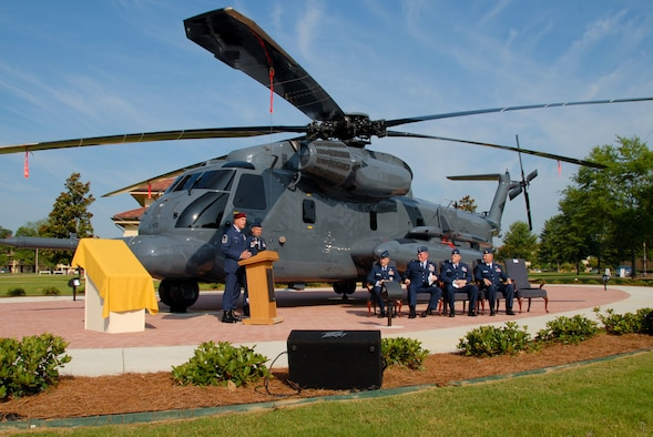 "An ""old war bird"" was dedicated Monday when a ceremony for Air Force Pave Low #69-5785, or 785, was held at Maxwell's Air Park. The static display at the corner of Ash and Twining Streets commemorates the Airmen who flew the helicopters first assigned to the Air Force in 1970. Retired Chief Master Sgt. Wayne Fisk, a pararescue jumper who flew on 785 many times, told the audience about the aircraft and his association with it. On the right, Lt. Gen. Allen Peck, Air University commander, Brig. Gen. Tom Trask of Air Force Special Operations Command, Col. Kris Beasley, 42nd Air Base Wing commander, and Maj. Brian Roberts, who flew 785 on her last flight, listened to Chief Fisk's speech. (U.S. Air Force photo/Jamie Pitcher)"