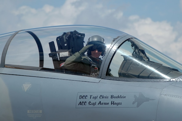 """Lt. Col Reed """"Snake"""" Drake salutes during his final take off during the end of era ceremony for the 131st Fighter Wing June, 13 2009. Lt. Col Drake is the squadron commander for the 110th Fighter Squadron at Lambert ANG base. (Photo by SrA Amber Hodges)"""