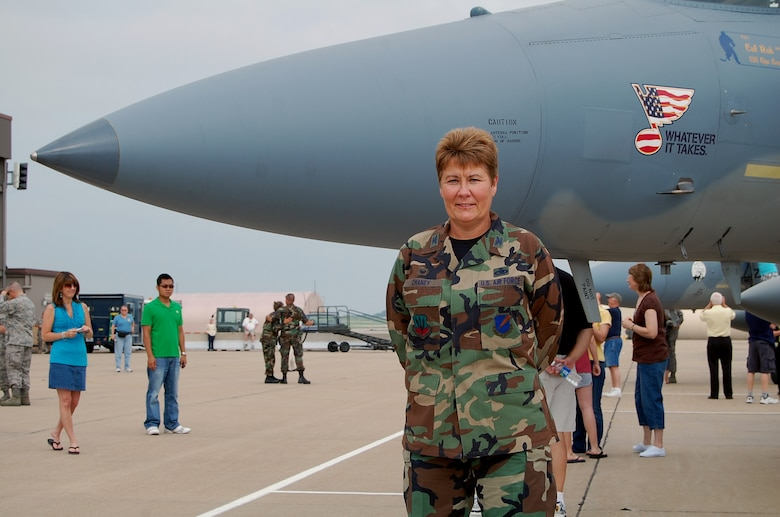 "Col. Terri Chaney, 131st Maintenance Group commander, stands in front of an F-15C at the 131st Fighter Wing, Lambert International Airport at the End of Era event June 13. ""It's a sad time for all of us,"" said Colonel Chaney. ""We leave today with a sense of pride."" (Photo by Senior Airman Jessica Donnelly)"