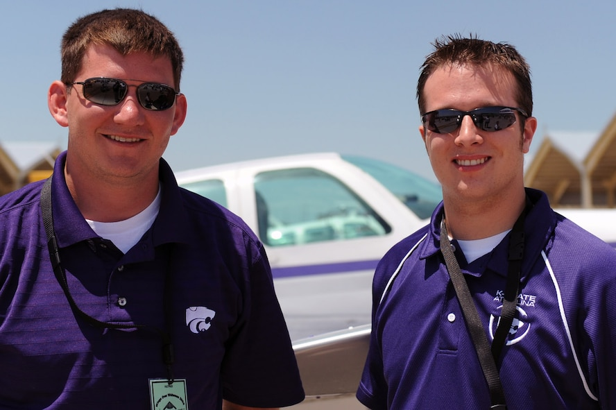WARRENSBURG, Mo. - Dan Bergman and Danny Sheehy from the Kansas State Aviation program pose in front of their school's aircraft during the Wings Over Whiteman Air Show and Open House June 6. Another college aviation program at the air show Saturday, the University of Central of Missouri, is based in Warrensburg, Mo. (U.S. Air Force photo/Senior Airman Jason Huddleston)