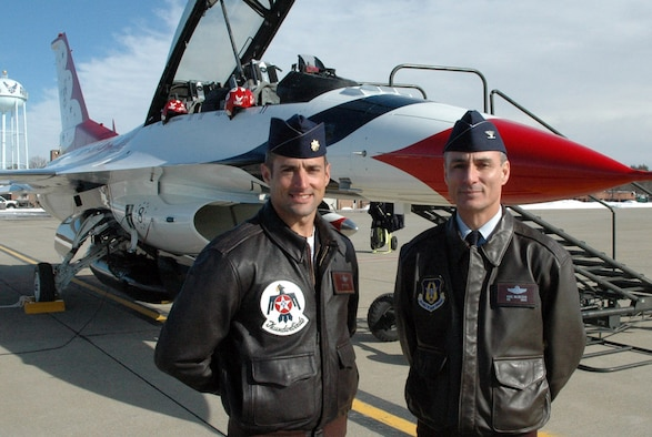 "YOUNGSTOWN AIR RESERVE STATION, Youngstown, Ohio -- Maj. Tony Mulhare, a member of the U.S. Air Force Thunderbirds aerial demonstration team, visits with Col. Karl McGregor, the commander of the 910th Airlift Wing, about ""Thunder Over the Valley"" the base's upcoming air show and open house.  The 2009 Youngstown Air Reserve Station Air Show and Open House will take place August 8 and 9, featuring live entertainment, static displays, flying demonstrations including the Thunderbirds and more.
