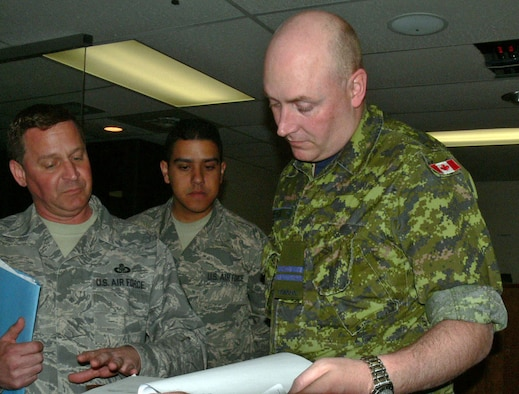 Senior Master Sgt. Paul Veresko from the 439th Air Lift Control Squadron Westover Air Reserve Base, Mass. and Staff Sgt. Johnathan Concepcion of the 512th ALCF Dover Air Force Base, Del. recieve guidance from a captain in the Canadian Air Force prior to conducting an airfield survery. The survey of the airfield at Cold Lake Air Base Alberta Canada will be given to the Canadian Air Force as well as updated in Air Mobility Command's database. Members from the 512th and 439th ALCFs were in Cold Lake supporting Maple Flag Exercise 42. (U.S. Air Force photo/2nd Lt Joe Simms)