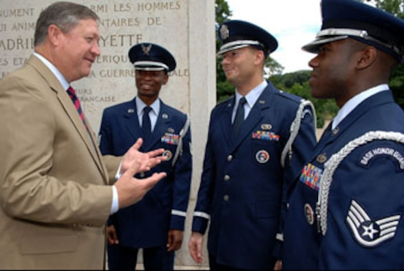 "MARNES-LA-COQUETTE, FRANCE — Secretary of the Air Force Michael B. Donley praises Tech. Sgt. Mike Jackson, 1st Lt. Chris McDaniels and Staff Sgt. Fred Stevenson, members of the 52nd Fighter Wing, Spangdahlem Air Base Honor Guard in Germany, for their support to the wreath laying ceremony at the Memorial de l'Escadrille La Fayette just outside of Paris June 13. The ceremony attended by U.S. senators, the Secretary of the Air Force, U.S. and French dignitaries, paid honor to the American volunteer combat flying aces known as the ""Lafayette Escadrille"" who flew under the French flag during World War I. (Department of Defense photo by Master Sgt. Bill Gomez)"