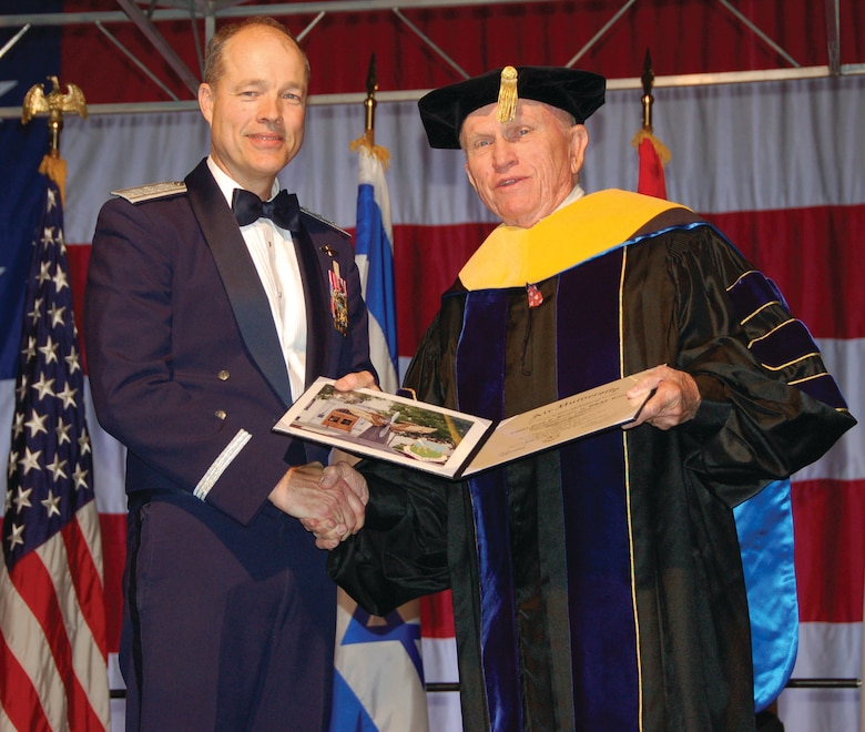 Lt. Gen. Allen G. Peck, the Air University commander honored retired Col. Frank Borman, former astronaut and Air Force officer with an Air University honorary doctor of science degree at the USAF Test Pilot School graduation Saturday. Colonel Borman led the Apollo 8 to be recognized as the first spacecraft to orbit the earth. (U.S. Air Force photo/Senior Airman Melissa Copeland)