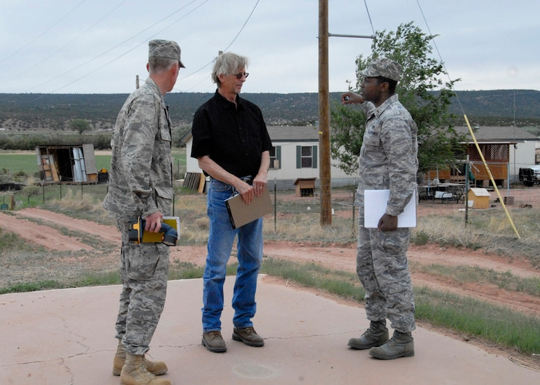 Lt. Col. Thomas Niichel and 2nd Lt. Rexford Cannady of the 240th Civil Engineer Squadron, speak with James Connor, education director for St. Michael?s School June 8, 2009. The three are discussing ideas for the revamping of the five-acre complex near Window Rock, Az. Association for Special Education.