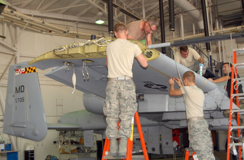 A team of Idaho Air National Guard maintainers from the 124th Wing at Gowen Field in Boise, Idaho reinstall the leading edges on the wing of a Maryland Air National Guard A-10 Thunderbolt II.  The aircraft received a new AAR-47 infrared missile warning system as part of the A-10 Consolidated Install Program June 16.(Air Force photo by Master Sgt Tom Gloeckle)(Released)