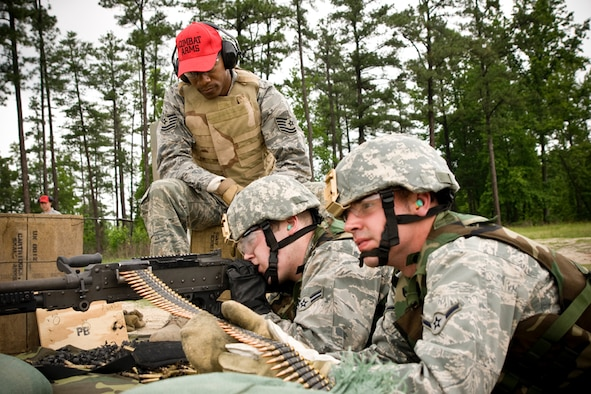 Tech Sgt. Duane Fowler looks over Airman 1st Class Franklin Holtman and Airman Andrew Landolina as the fire the M240 for the annual qualification.  Each year, members of the 459th Security Forces Squadron are required to fire 1,100 rounds from both the M240 and M249. (U.S. Air Force Photo/ Capt. Nick Strocchia)