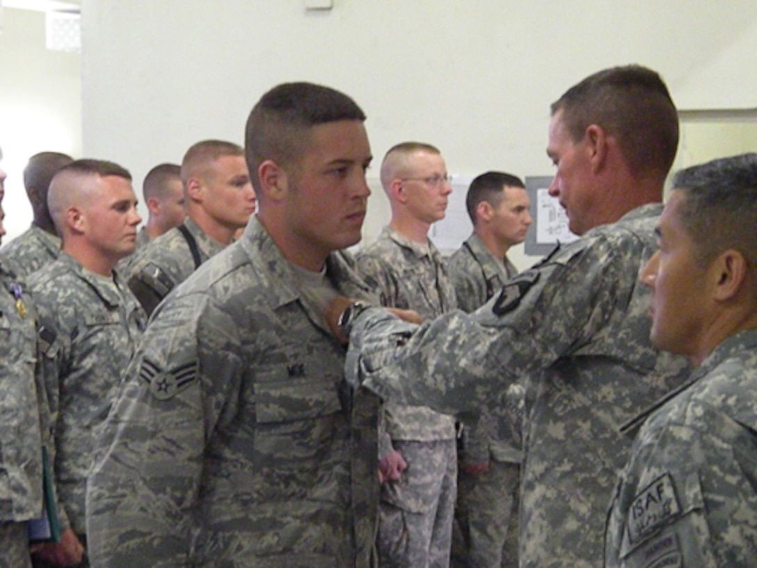 Members of the 139th Security Forces Squadron earned Combat Action Badges and coins recognizing excellence from a two-star army general while deployed to Afghanistan in support of the Missouri Agri-Business Development Team there.