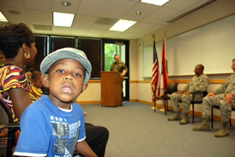 Capt. Marcus Jackson's son, Isaiah, has his attention elsewhere during his father's change of command ceremony.