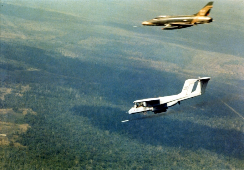 An OV-10A firing a smoke rocket in the area north of Saigon in February 1969 to show where the F-100 should drop its bombs. (U.S. Air Force photo)