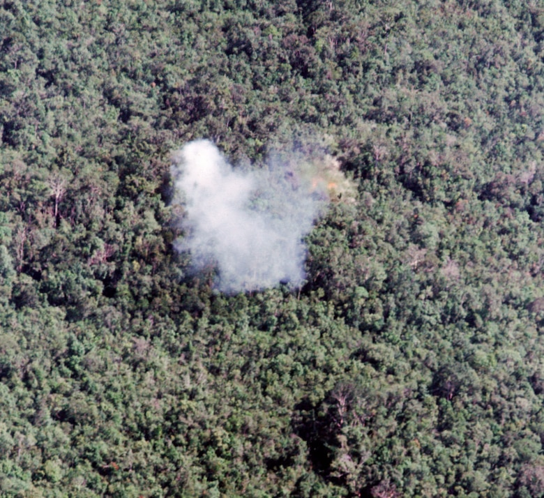 Smoke from a white phosphorus rocket marking the target. The FAC used this smoke to guide the strike aircraft and direct the attack. When certain that the fighter pilot was attacking the correct target, using the right weapons, and not threatening friendly troops or civilians, the FAC gave permission to attack. (U.S. Air Force photo)