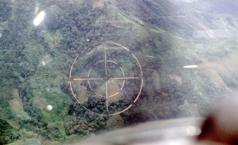 After identifying a target, the FAC called for attack aircraft and marked the target.  Here, an O-2 FAC fires a white phosphorus rocket (just to the right of the gunsight's crosshairs) near Phan Rang in 1969. (U.S. Air Force photo)
