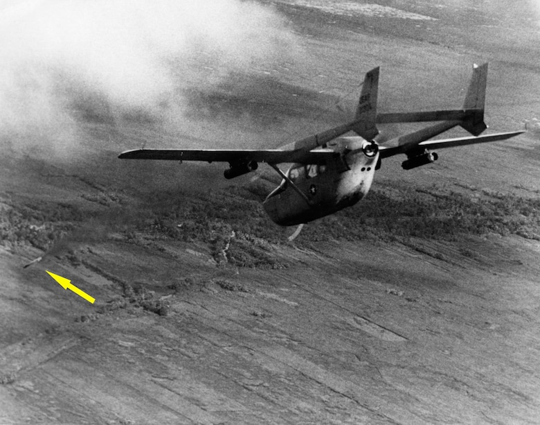 The Cessna O-2A Super Skymaster was used as an interim FAC aircraft and for psychological warfare missions. Here, an O-2A FAC fires a smoke rocket (indicated by the arrow) to mark an enemy stronghold for strike aircraft. (U.S. Air Force photo)