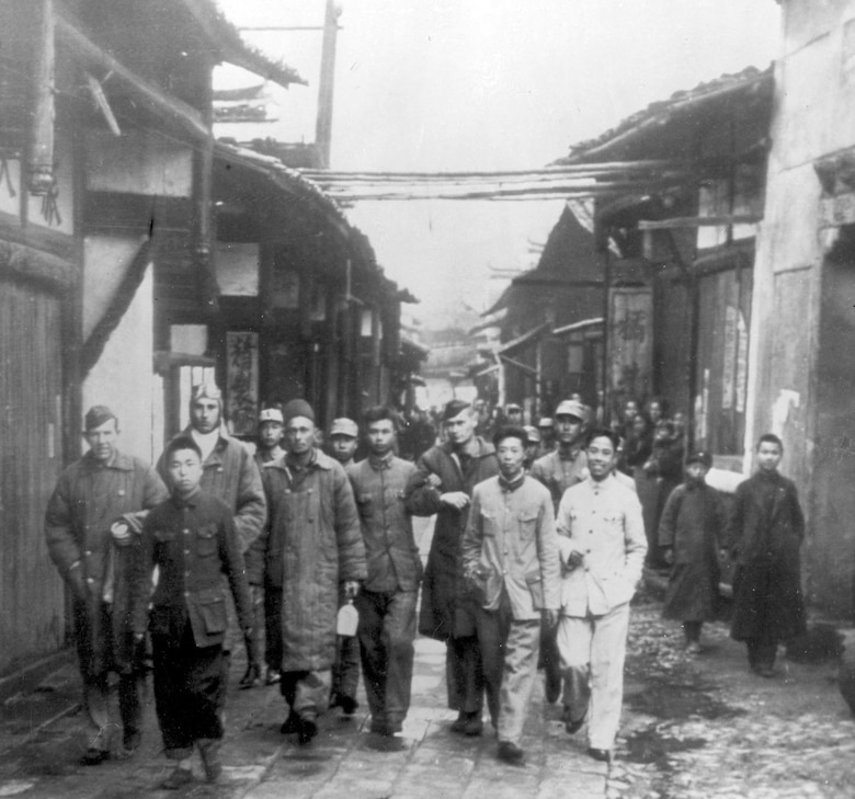 Pictured shortly after the raid (l to r) are Lt Herb Macia, Lt Jack Sims, Sgt Jacob Eierman, and Maj John Hilger alongside Chinese villagers who risked their lives to help them.  It is estimated that Japanese forces executed as many as 250,000 Chinese in retaliation for the raid and subsequent Chinese assistance to the Raiders.(U.S. Air Force photo)