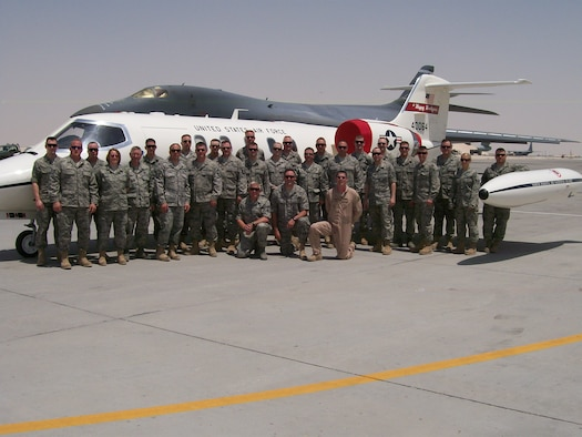Airmen from the 119th Wing, North Dakota Air National Guard, stand in front of a C-21 Lear Jet in South West Asia.  For the first time in the history of the U.S. Central Command, the C-21s, the military version of the Learjet 35A, are being maintained by Airmen rather than contractors.