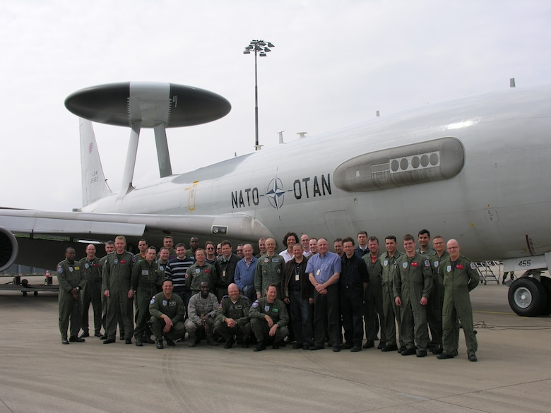 Members of a special E-3 Airborne Warning and Control System testing team pose for a group photo after a flight trial held in Germany last month. The ground and flight tests on a NATO AWACS made strides in proving that the waveforms cause no interference to military and civilian air traffic control. Participants included representation from ESC's 635th Electronic Systems Squadron, Belgium, the European Union, France, Germany, Italy, NATO, the Netherlands, United Kingdom and United States. (Courtesy photo)