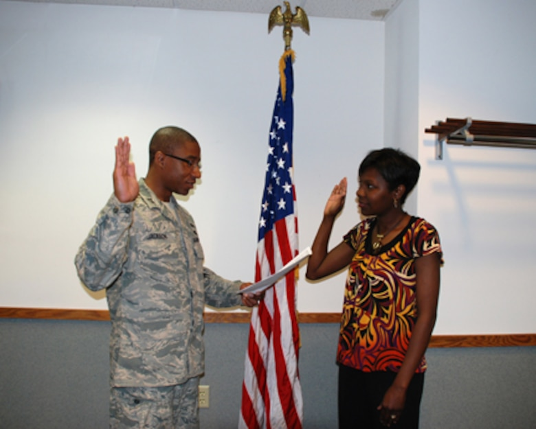 Capt. Marcus Jackson swears in Senior Airman Latrik Shajuan Jackson, his wife, here at Rosecrans ANGB, Mo., during the June UTA. Senior Airman Jackson, an administrative specialist, was previously assigned to the 139th Logistics Squadron in 1997-98. She decided to rejoin the 139th as she completes her last year as a nursing student in Kansas City. She will be assigned to the maintenance shop.