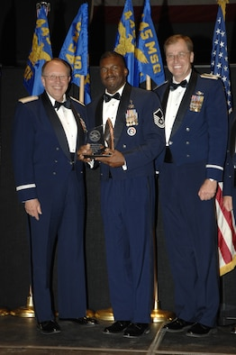WRIGHT-PATTERSON AIR FORCE BASE, Ohio - Master Sgt. Mark Lyle, 445th Mission Support Group and Superintendent of the Wright-Patterson Air Force Base active duty honor guard, was selected as the 2008 Base Honor Guard Program Manager of the Year for the Air Force. He's shown here being congratulated by Lt. Gen. Charles E. Stenner, Jr, Chief of Air Force Reserve and Commander, Air Force Reserve Command, and Col. Stephen D. Goeman, 445th Airlift Wing Commander.  The Honor Guard is dedicated to supporting the ceremonial needs of the 445th Airlift Wing and the greater Miami Valley communities by proudly performing as professional representatives of the United States Air Force.