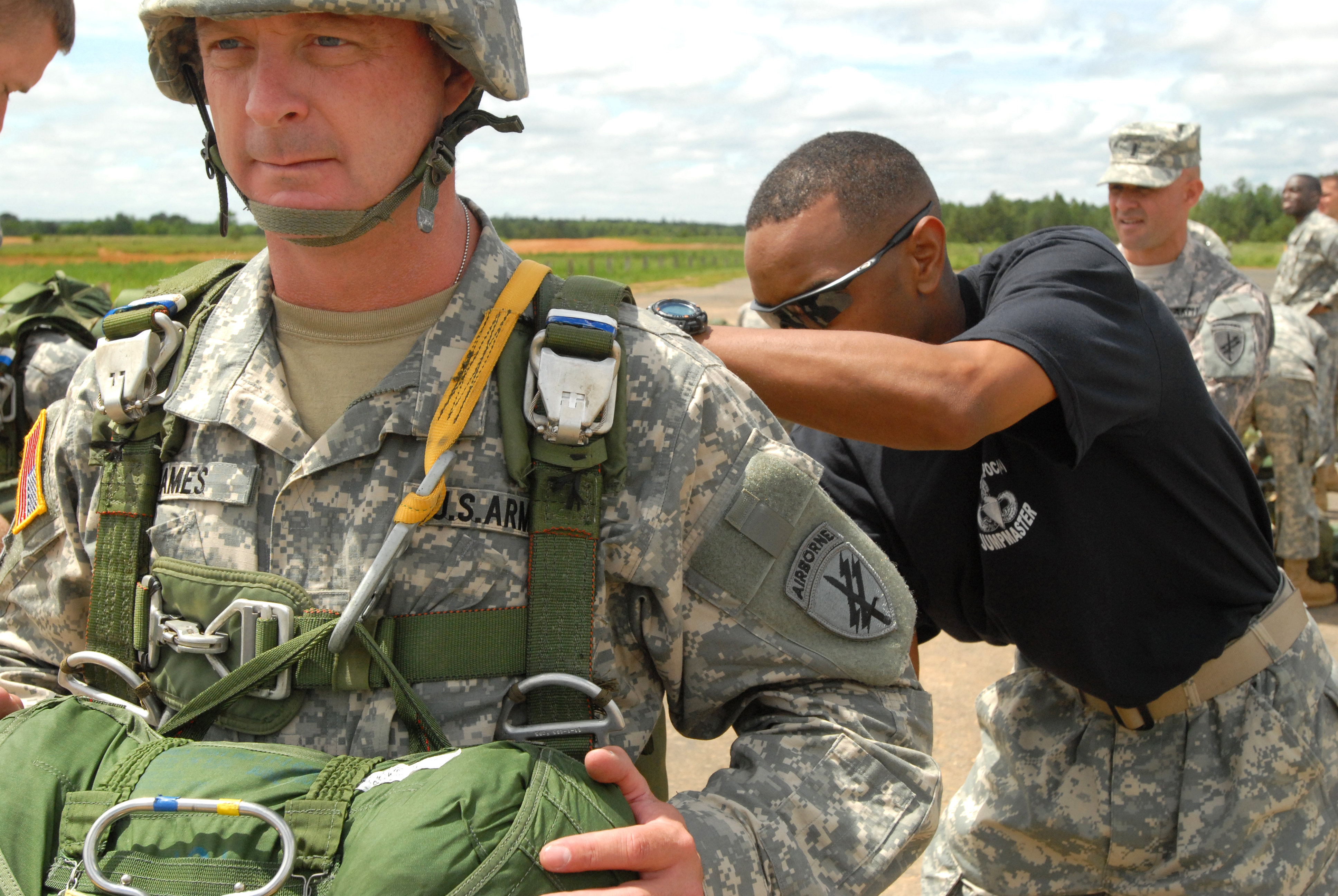 US Army Master Sgt Dwight Simon Right Conducts Jumpmaster Personnel Inspection On 1st Stuart James Before A Mock Normandy Air Operation Fort