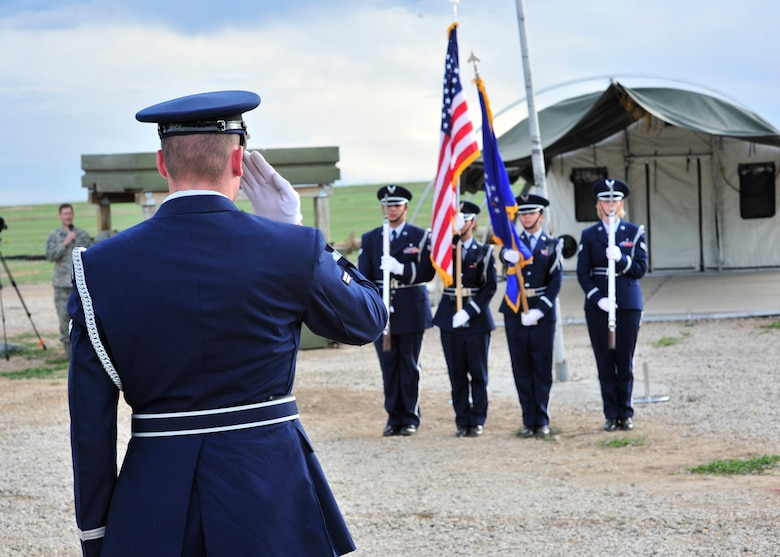 BUCKLEY AIR FORCE BASE, Colo. -- The Mile High Honor Guard present the Colors at the Combat Dining-in May 29 at Camp Rattlesnake here. More than 100 people showed up for the event. (U.S. Air Force photo by Senior Airman Alex Gochnour)