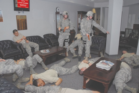 During the June Maxwell-Gunter exercise Officer Training School shooting scenario, 42nd Security Forces Squadron members enter a break area of the school to find mass casualties. In all, 12 OTS students, a bystander and the distraught gunman died in the exercise that involved a grudge against a student at OTS. (U.S. Air Force photo/Jamie Pitcher)