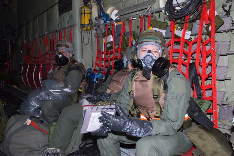 Airmen of the 109th Aeromedical Evacuation Squadron wear Mission-Oriented  Protective Posture level 4 meaning wearnig the full gas mask, gloves, and boots in bay of a C-130 Hercules May 16, 2009. Hundreds of men and women from the Minnesota Air National Guard unit joined otheres from Scott Air Force Base, Illinois for Readiness Safeguard in preparation for an Operational Readiness Inspection. USAF Official photo by Technical Sgt. Erik Gudmundson.(Released)