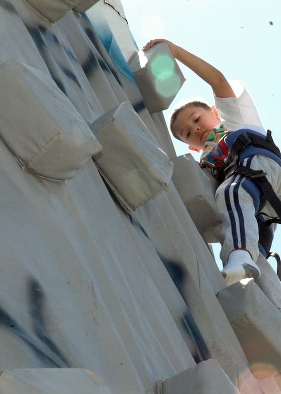 BUCKLEY AIR FORCE BASE, Colo. -- Quentin Lovejoy, son of the 460th Space Wing Legal Office's Maj. Theresa Love, descends an inflatable rock climbing wall at the base softball fields, June 6. An estimated 2,000 people enjoyed the festivities sponsored by Buckley's Integrated Delivery Services and the 460th Space Communications Squadron partnered with the United Service Organizations, United States Automobile Association and Operation Kids. (U.S. Air Force photo by Staff Sgt. Sanjay Allen)