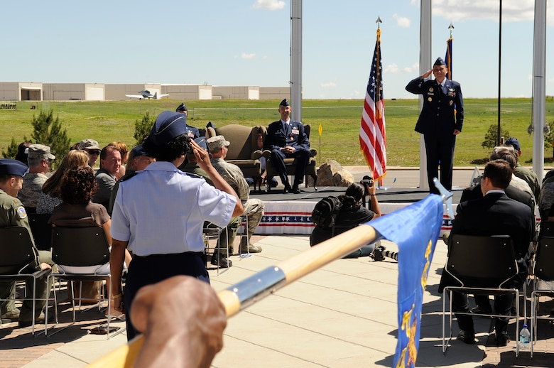 BUCKLEY AIR FORCE BASE, Colo. – Col. Clinton Crosier receives his first salute as the 460th Space Wing commander from Col. Charlotte Wilson, 460th SW vice commander during an official ceremony here, June 19.  Colonel Crosier was previously the Deputy Director of Plans and Programs, Headquarters Air Force Space Command, Peterson AFB, Colo.  (U.S. Air Force photo by Senior Airman Steven Czyz)