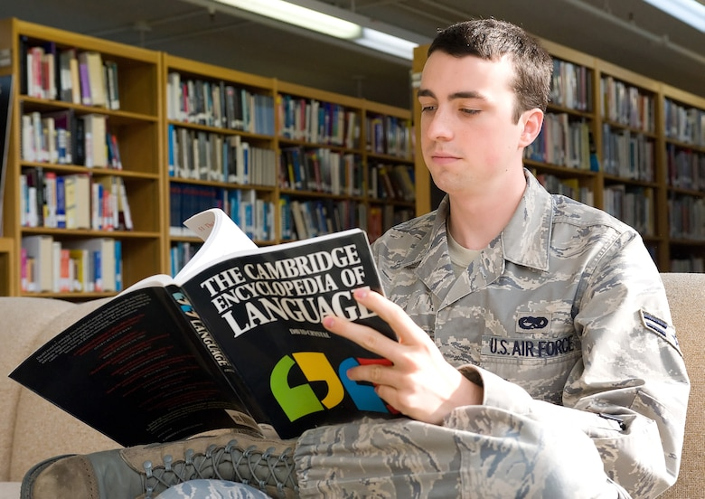 Airman 1st Class John Harris, Maintenance Operations Squadron maintenance scheduler, reads a book at Dover Air Force Base's Base Library. The library offers a wide variety of classes, Web access, newspaper articles and magazines, downloadable audiobooks, study guides and books to help prepare for college level examination program exams and language-learning software, all of which is available at no cost. (U.S. Air Force/Tom Randle)