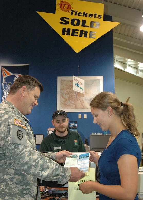 BUCKLEY AIR FORCE BASE, Colo. – Col. Ken Lull, Colorado Army National Guard, reviews a brochure on June 3 with Kelly Weatherman, a student at Colorado State University, as Brian Spann looks on. Colonel Lull rented a Casita tow-behind trailer the week of Memorial Day and stopped by Outdoor Recreation/Information, Tickets and Travel with his friend's daughter, Kelly, to show her the base source for tickets to Disney World and other interesting places. (U.S. Air Force photo by Master Sgt. Dorothy Goepel)