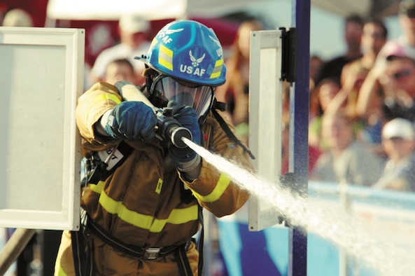 U.S. Air Force Academy firefighter Patrick Kraft shows off his hose technique Aug. 11, 2006, during the 2006 Firefighter Combat Challenge regional competition in Westminster, Colo.Kraft will compete with Team USAFA in 2009 after strong finishes in World Firefighter Combat Challenges in 2006, 2007 and 2008. The 2009 challenge is open to the public and will be held at the Air Force Academy. (U.S. Air Force photo/John Van Winkle)