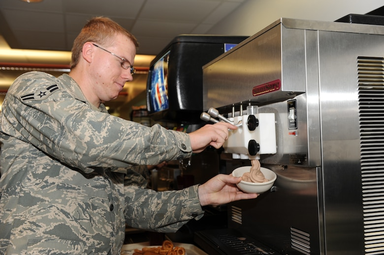 WHITEMAN AIR FORCE BASE, Mo. - Airman 1st Class Steven Carpenter, 509th Mission Support Group, knowledge operations management, enjoys the Ozark Inn's new soft serve ice cream machine, June 19. Along with the chocolate soft serve, Ozark Inn serves Nestle ice cream bars and cakes and pies for dessert. (U.S. Air Force Photo/ Airman 1st Class Carlin Leslie)