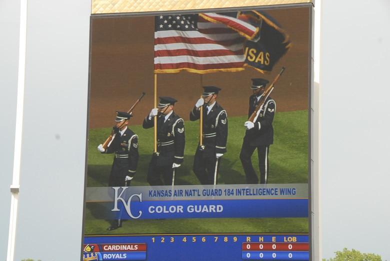 062009-F-6174J-010- (l-r) SSgt Francis Nguyen, SSgt Jason Harkness, SSgt Aaron Santry, and SrA Byron Smith present the colors at the Kansas City Royals game at Kaufman Stadium on June 20, 2009. Video of the 184th Intelligence Wing Honor Guard was shown on the jumbo-tron for the entire stadium to see. (Photo By: SSgt Justin Jacobs)